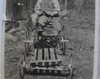 vintage photo proud boy with go cart