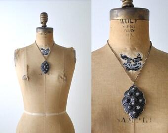 Vintage pendant necklace. cast metal. dark silver. art nouveau. chain