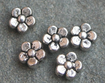 Silver tone flower spacers
