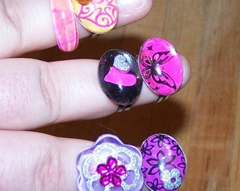 6 plastic Bling Rings, 4 adjustable