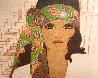 Vintage framed artwork of glamorous lady with green eyes and tan skin.