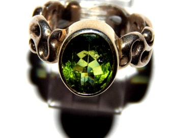 Peridot Oval Faceted Ring With Sterling Silver Band