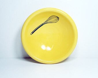 small dish, with a whisk shown here on lemon butter, made to order / pick your colour