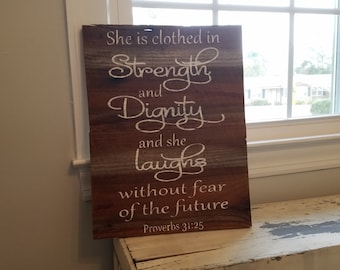She is clothed in strength and Dignity Proverbs 31:25 Wood Sign