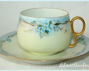Beautiful hand painted tea cup (DAMAGED HANDLE) & saucer with blue flowers