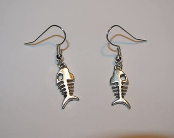 pair of fish skeleton earrings