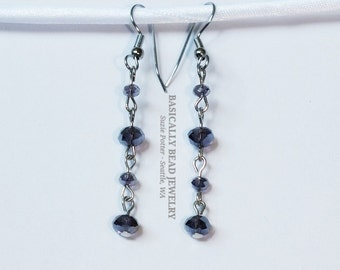 """These 1 1/2"""" long hand chained earrings are made with 14mm & 6mm lavender sparkly glass rondelles on surgical steel earwires"""
