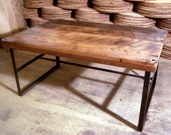Reclaimed wood coffee table with industrial metal base