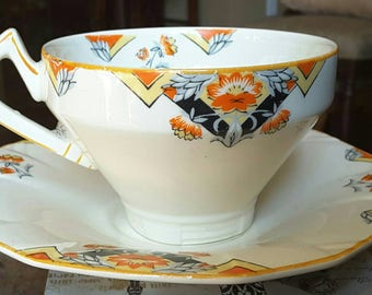 Art Deco Alfred Meakin Balmoral pattern, Marigold Princess Shape 16 teacup and saucer
