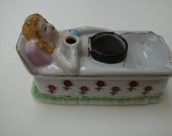 1950's reclining woman ashtray-porcelain