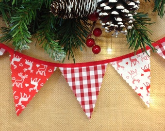 Nordic mini bunting with red & white stags and gingham attached to red tape, perfect for a traditional Christmas