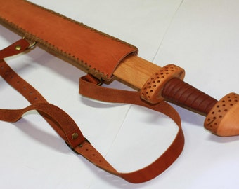 Toy wooden sword with leather sheath