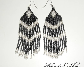 Earrings woven black, white details.
