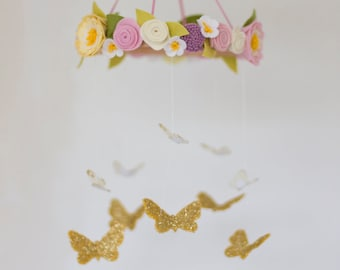 Butterflies and spring flowers baby mobile in muted pastels; dusty pink, lavender and palest yellow with gold butterflies. Vintage style.