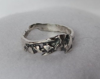 Silver nugget designed band ring with a band shaped for comfort on the hand.  Hand forged and fused for an organic unisex style.  Size 8.5