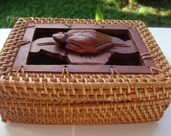 Wood box made of woven rattan and turtle sculpture