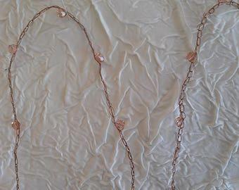 pair of jewelry beads strap pink swarovski on copper metallic thread. length 37 cm.