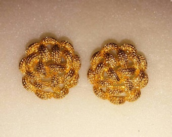Vintage Monet braided golden pierced bold earrings.