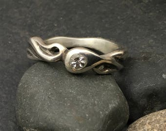 Sterling silver ring with a tiny flush set 3 mm sparkling white topaz, slim flowing sculptural design, size 6 & 1/2, one of a kind