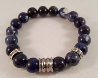 Gemstone bracelet made of sodalite, fluted stainless steel beads and Strassrondelle