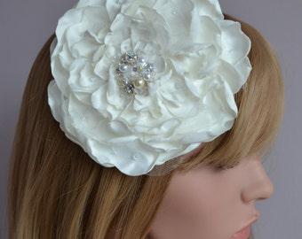 Large flower bridal fascinator.