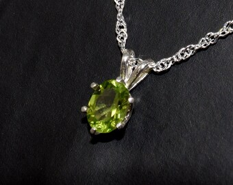Natural, Vivid Green, Peridot Gemstone.  August.  8x6, Oval, 1.42 ctw.  Grade AAA.  6-Prong Sterling Silver Pendant with Chain Selection.