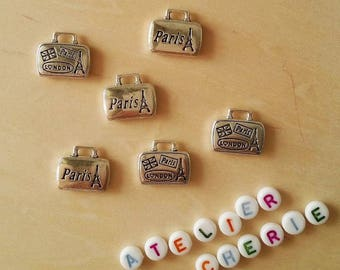 """Lot 5 """"Paris / London"""" suitcase in antique silver charms"""