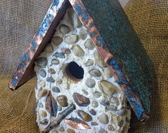 Stone Birdhouse with copper pattina roof. Outdoor protected. Easy clean out bottom and hanger included.