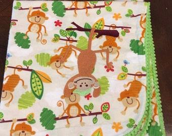 Flannel receiving blanket, Swinging Monkey
