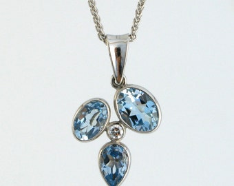 KALEIDOSCOPE 18k white gold pendant with 3 sky blue topaz droplets and diamond - gemstone necklace in 18k white gold