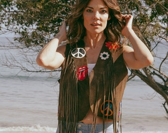 Vintage 1970's fringed vest with patches