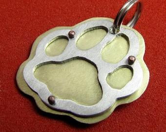 Paw tag in brass and aluminum