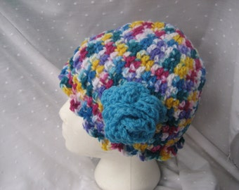 Multi color beanie hat with turquoise flower