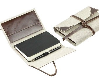 Pocket notebook with leather strap in a linen/leather combination