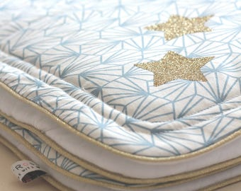Golden details and graphic fabric baby blanket