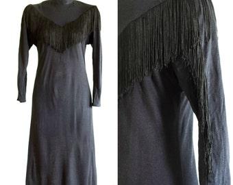 Black long sleeve sheath dress with fringe detail