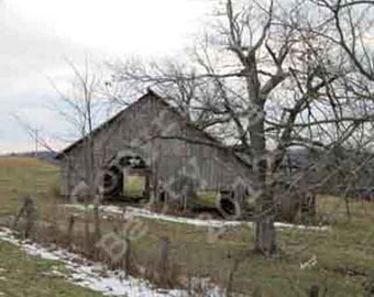 Old Barn in snow on side of road photograph