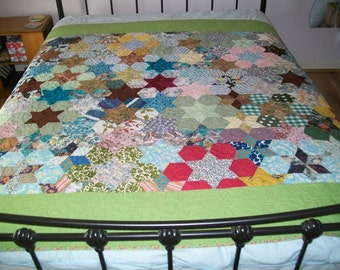 Handmade VINTAGE hand pieced patchwork, newly remade into a beautiful quilt