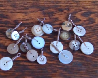 5 buttons on a necklace