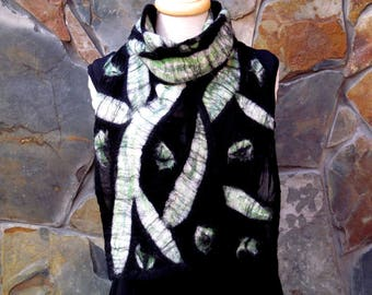 Nuno felt scarf on black silk with a white and green abstract line design