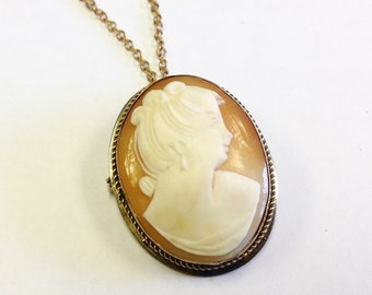 Vintage, shell cameo, pendant brooch on gold tone chain.