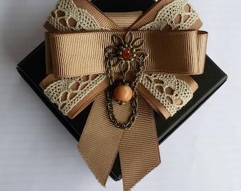 Handmade brooch decorated with sun stone.