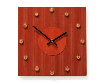 Red clock with numbers