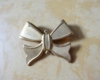 BRASS bow pendant