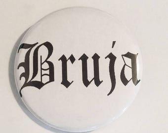 "BRUJA PIN BUTTON black font on white 1.5"""