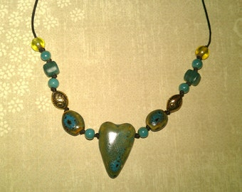 shades of green beaded necklace with heart accent