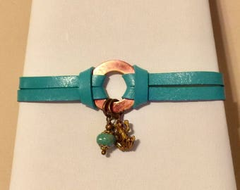 Turquoise leather bracelet with copper and frog charm