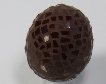 Chocolate egg with tiles and earthenware sepia