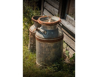 Vintage Creamery Milk Cans by the old Prairie Homestead near the Badlands  in South Dakota No.7561 A Fine Art Still Life Photograph