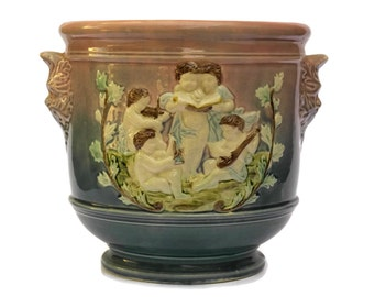 Antique French Majolica Cache Pot with Cherub Figures.